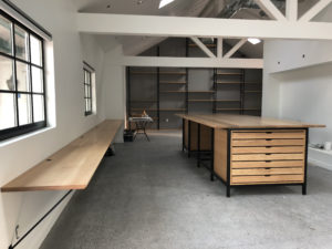 Custom workstations, conference table, and shelves