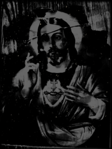 Graphic design of Jesus in black and grey with stripes