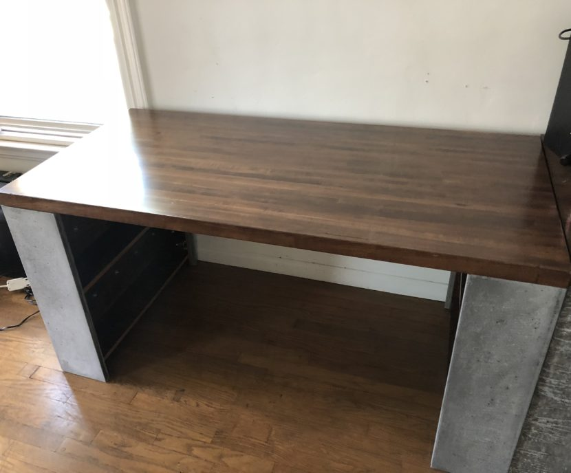 Concrete desk with shelves